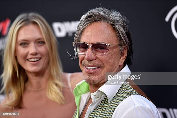 "Model Anastassija Makarenko and actor Mickey Rourke arrive at the Premiere of Dimension Films' ""Sin City: A Dame To Kill For"" at TCL Chinese Theatre..."