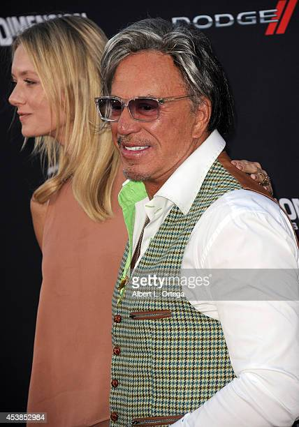 "Model Anastassija Makarenko and actor Mickey Rourke arrives for the Premiere Of Dimension Films' ""Sin City: A Dame To Kill For"" held at the TCL..."