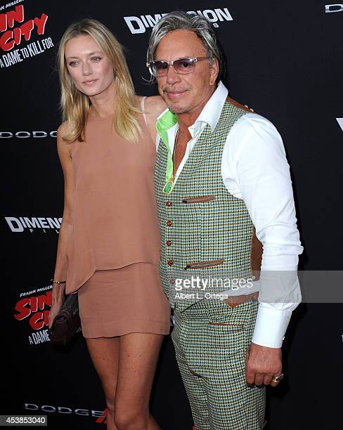 Model Anastassija Makarenko and actor Mickey Rourke arrives for the Premiere Of Dimension Films' 'Sin City A Dame To Kill For' held at the TCL...
