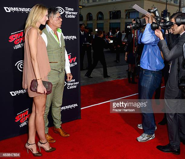 Model Anastassija Makarenko and actor Mickey Rourke attends Premiere of Dimension Films' 'Sin City A Dame To Kill For' at TCL Chinese Theatre on...