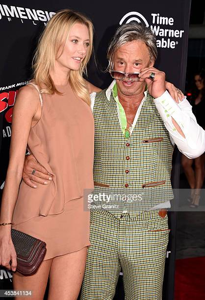 "Model Anastassija Makarenko and actor Mickey Rourke attends the ""Sin City: A Dame To Kill For"" Los Angeles premiere at TCL Chinese Theatre on August..."