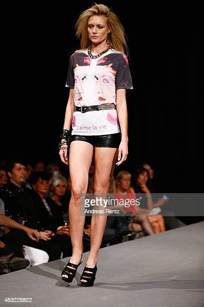 Model Anastassija Makarenko walks down the runway during the GarconF fashion show at BalloniHallen on August 5 2014 in Cologne Germany