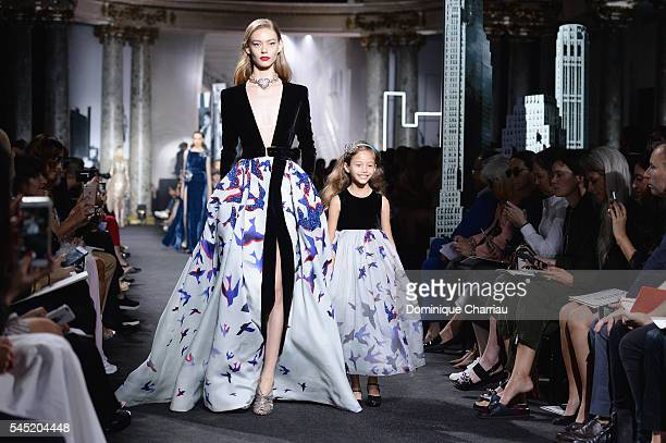 Model and a child model walk the runway during the Elie Saab Haute Couture Fall/Winter 2016-2017 show as part of Paris Fashion Week on July 6, 2016...