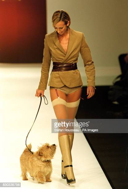 A model and a dog parade the catwalk wearing designs by Scott Henshall during London Fashion Week