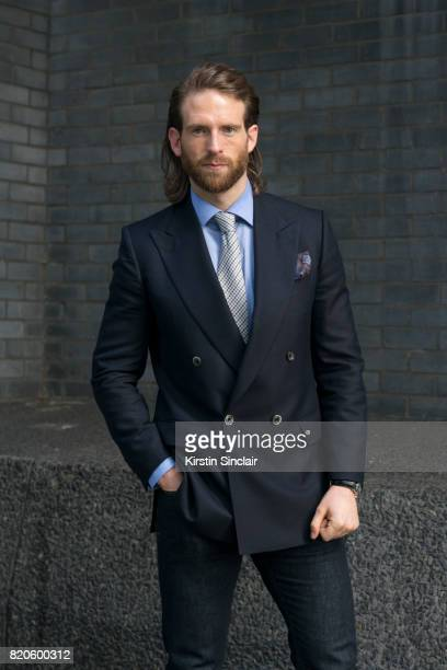Model and Actor Craig McGinlay wears Massimo Dutti jeans Chester Barrie Blazer shirt tie and pocket square on day 3 of London Collections Men on June...