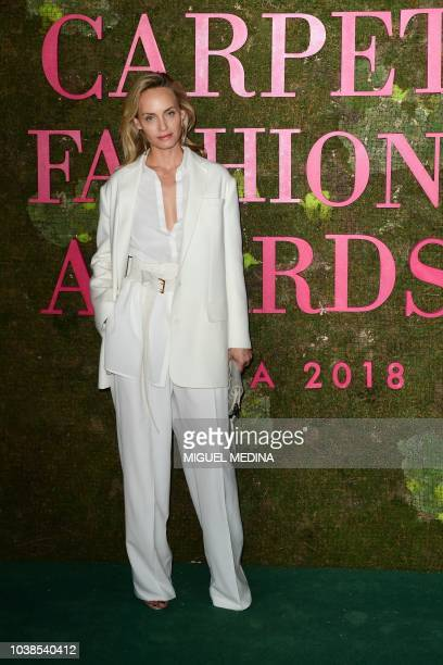 US model and actress Amber Valletta poses as she arrives to attend the Green Carpet Fashion Awards 2018 within the Women's Spring/Summer 2019 fashion...