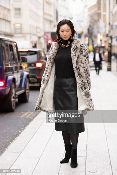 Model and Actress Betty Bachz wears a leopard print faux fur coat with a leather skirt and black boots during London Fashion Week Men's January 2019...