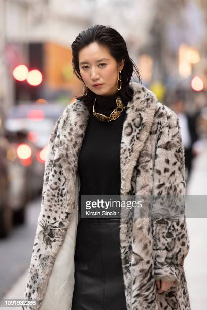 Model and Actress Betty Bachz wears a leopard print faux fur coat with a leather skirt during London Fashion Week Men's January 2019 on January 07...