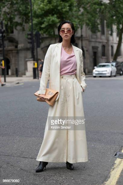 Model and Actress Betty Bachz wears Moy Atelier sunglasses Max Kohen bag and a King and Tuckfield suit during London Fashion Week Men's on June 9...