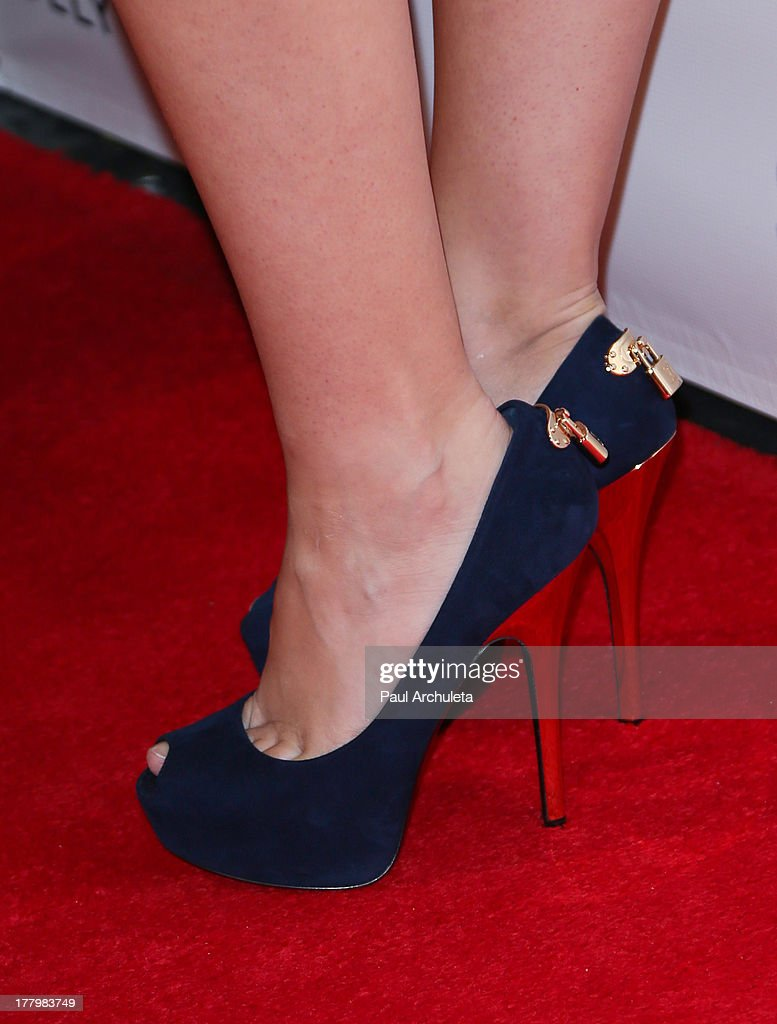 Model and actress Caitlin O'Connor (shoe detail) attends the Viva Glam Magazine Summer 2013 issue launch party at W Hollywood on August 25, 2013 in Hollywood, California.
