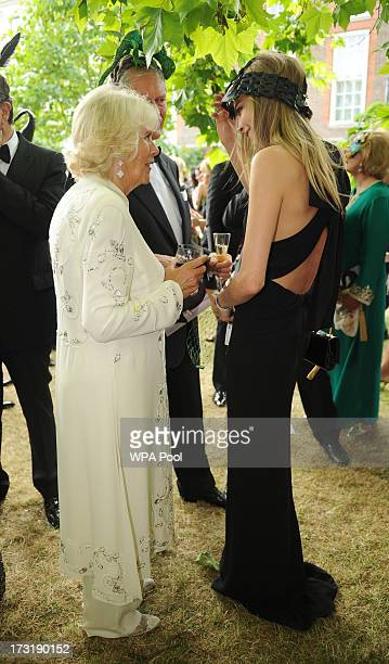 Model and actress Cara Delevingne meets with Camilla Duchess of Cornwall at a reception hosted by Prince Charles Prince of Wales and Duchess of...