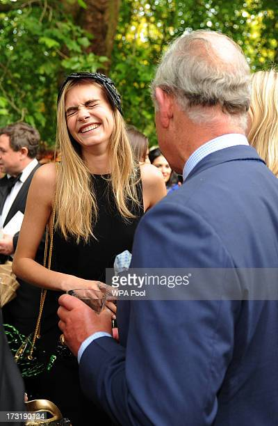 Model and actress Cara Delevingne meets with Prince Charles Prince of Wales as she attends a reception hosted by The Prince of Wales and Duchess of...