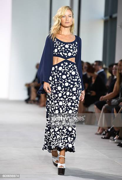 Model and actress Carolyn Murphy displays fashions during the Michael Kors Spring 2017 Runway Show during New York Fashion Week in New York on...