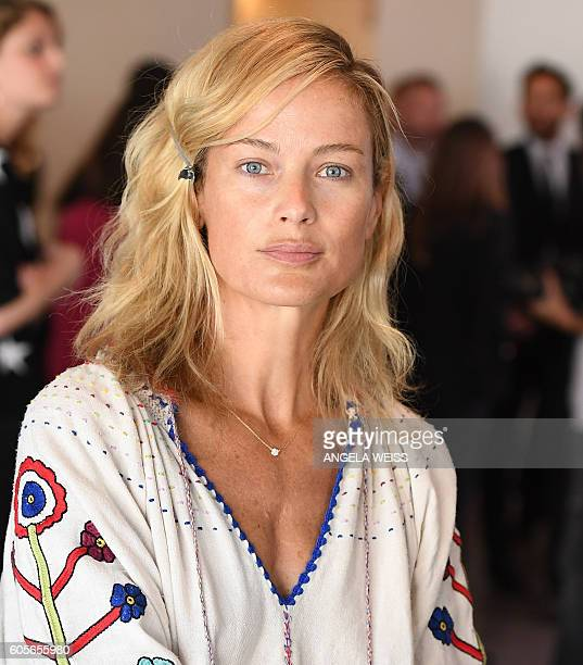 Model and actress Carolyn Murphy prepares backstage the Michael Kors Spring 2017 Runway Show during New York Fashion Week in New York on September 14...