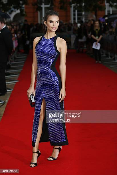 US model and actress Emily Ratajkowski poses on arrival for the premiere of We Are Your Friends in London on August 11 2015 TALLIS