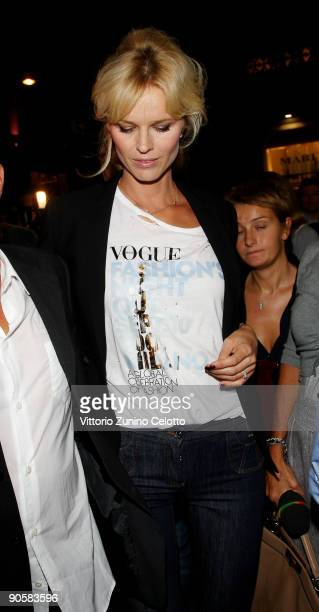 Model and Actress Eva Herzigova arrives at the Giorgio Armani boutique during the VOGUE Fashion's Night Out on September 10 2009 in Milan Italy