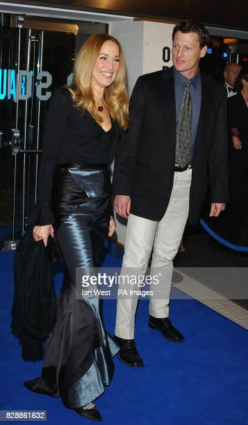 Model and actress Jerry Hall and TV explorer Benedict Allen arrive for the Royal Film Performance 2003 a charity screening of new film Master...