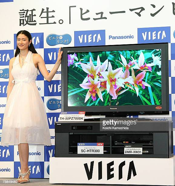 Model and actress Koyuki stands next to Matsushita Electric Industrial's leading brand Panasonic's World's first 42v plasma TV with full highvision...