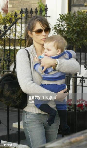 Model and actress Liz Hurley is seen leaving her London home with her son Damian March 14 2003 in West London Hurley was heading to Heathrow Airport...