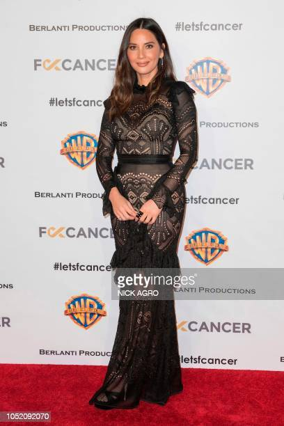 US model and actress Olivia Munn arrives for the F*ck Cancer Gala at Warner Bros Studio in Burbank California on October 13 2018