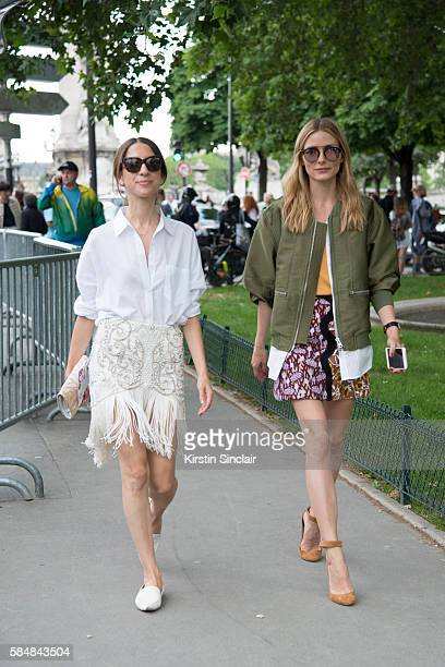 Model and Actress Olivia Palermo wears a Giambattista Valli skirt 31 Phillip Lim bomber jacket Dior sunglasses and Jimmy Choo shoes day 2 of Paris...