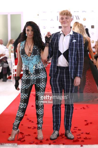 A model and Alex Pike walk the runway during the Alex Pike show at BNTB Cannes Fashion Week on May 14 2019 in Cannes France