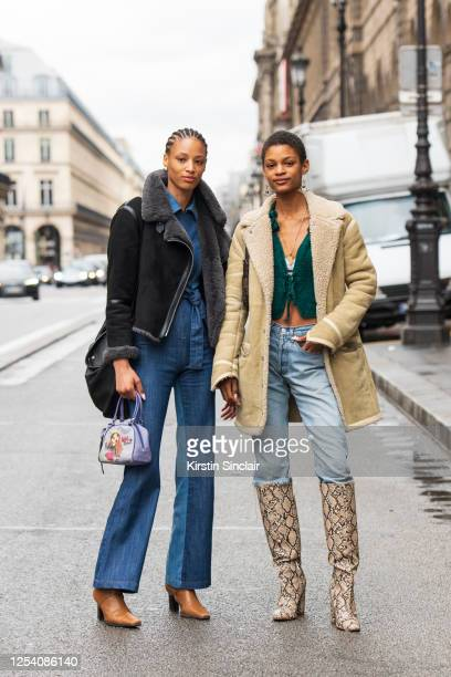 Model and artist Janaye Furman wears a denim jumpsuit, tan boots and a cropped black shearling jacket with Model Theresa Hayes wearing a shearling...