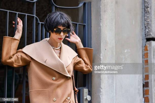 Model and artist Zoe Helali wearing a beige reversible cashmere coat by Gobi, sunglasses by Gucci and a pearl necklace by Celia von Barchewitz during...