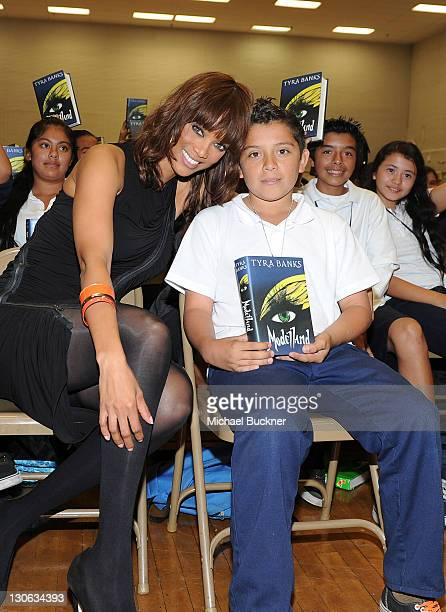 Model and author Tyra Banks surprises students at Mary McLeod Bethune Middle School for the Get Schooled Foundation on October 27 2011 in Los Angeles...
