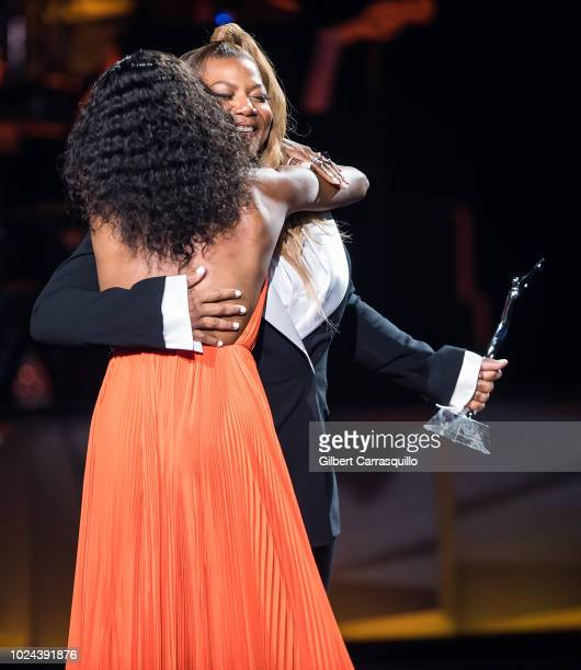 Model and Black Girl Magic Award Award recipient Naomi Campbell and actress/singer and 2018 Black Girls Rock host Queen Latifah on stage during the...