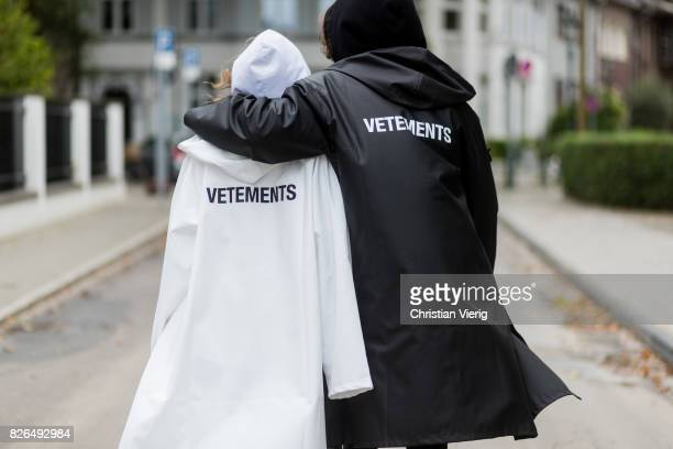 Model and Blogger Alexandra Lapp wearing oversized raincoat with a hood in white from Vetements, Vetements hoodie in white, destroyed Adriano...
