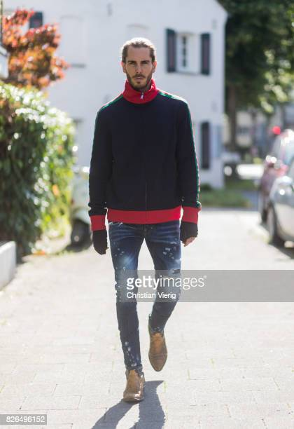 Model and Blogger Thomas Stuch wearing classic Kenny Twist Jean from Dsquared black TShirt Thom Krom Gucci track suit top Stallion Cowboy Boots on...