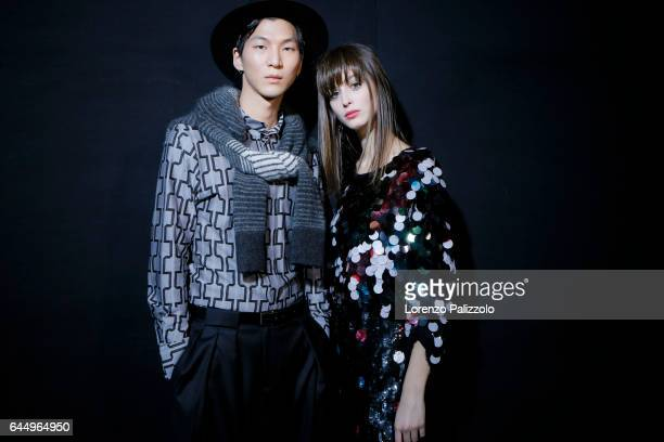 Model and Chiara Corridori are seen backstage ahead of the Emporio Armani show during Milan Fashion Week Fall/Winter 2017/18 on February 24, 2017 in...