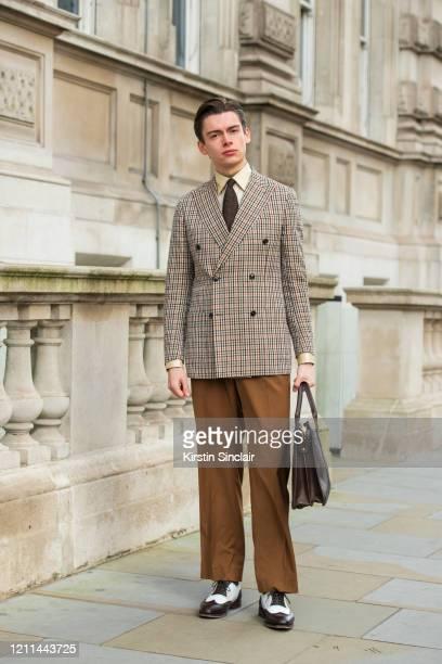 Model and creative director Mathias Le Févre wears a Dak's suit Eaton tie Frank Clegg bag Carmina shoes and an Edward Sexton shirt during London...