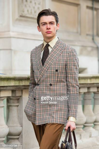 Model and creative director Mathias Le Févre wears a Dak's suit Eaton tie and an Edward Sexton shirt during London Fashion Week February 2020 on...