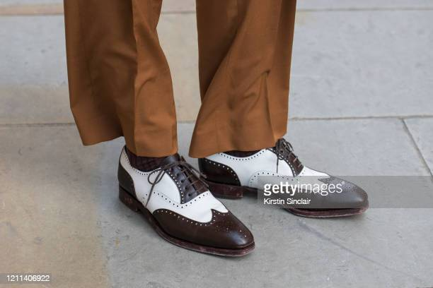 Model and creative director Mathias Le Févre wears Carmina shoes Dak's suit during London Fashion Week February 2020 on February 18 2020 in London...