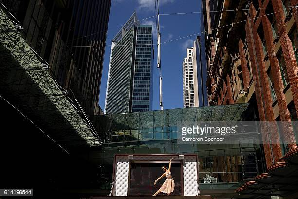 Model and dancer Mimi Elashiry performs on top of the world's first lifesize jewellery box in Pitt Street Mall on October 13 2016 in Sydney Australia