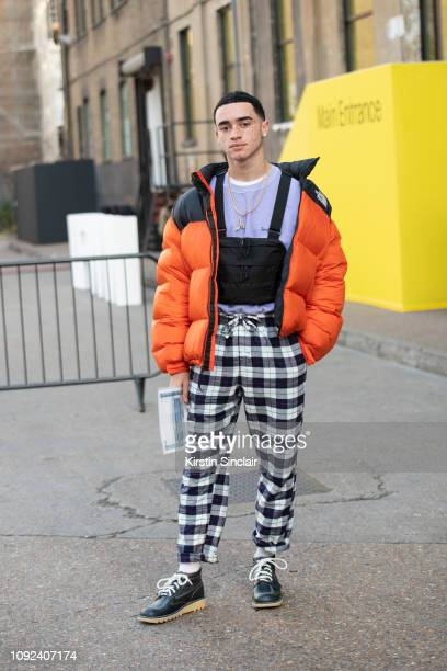 Model and dancer Taylor Kae Knott wears a North Face jacket Urban Outfitters jumper H M trousers Kickers shoes and an MIS California bag during...