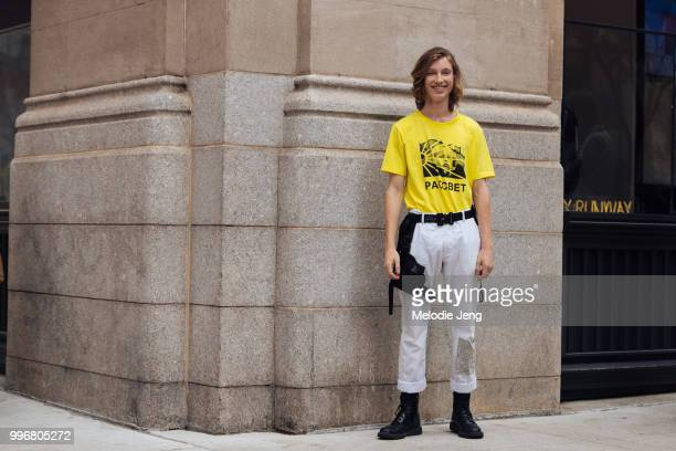 Model and designer Andrew Hubert in a yellow PACCBET tshirt Alyx black belt white jeans and black boots during New York Fashion Week Mens...