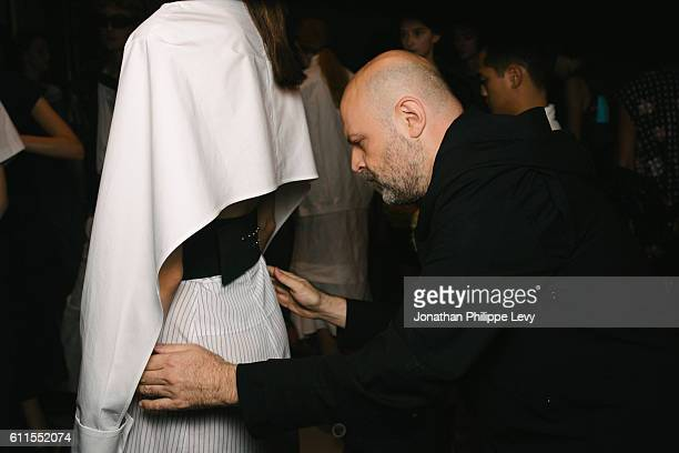 A model and Designer Hussein Chalayan pose prior to the Chalayan show as part of the Paris Fashion Week Womenswear Spring/Summer 2017 on September 30...