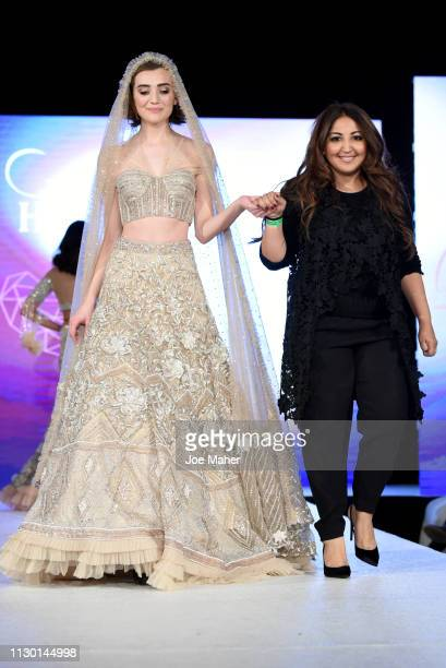 Model and designer walk the runway for Aarti Mahtani at the House of iKons show during London Fashion Week February 2019 at the Millennium Gloucester...