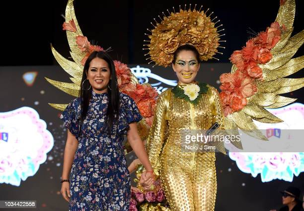 Model and designer walk the runway for JAL Fashion on day 2 of the House of iKons show during London Fashion Week September 2018 at the Millennium...