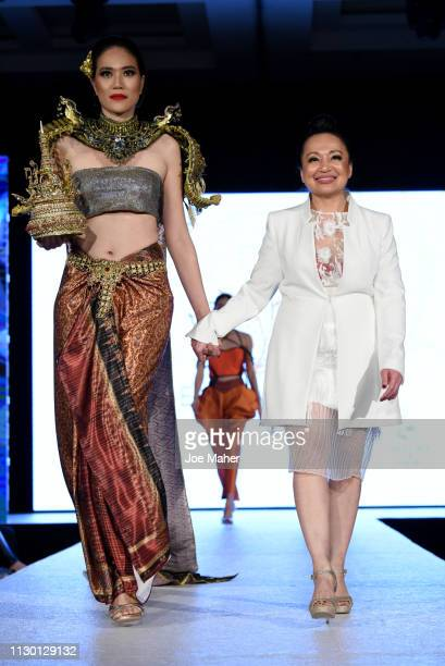Model and designer walk the runway for Mullika Nakara at the House of iKons show during London Fashion Week February 2019 at the Millennium...