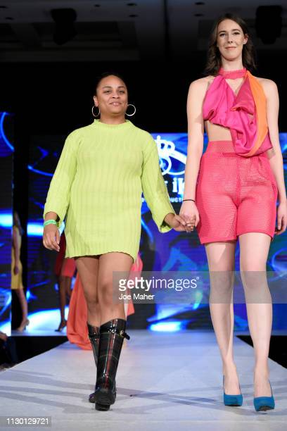 Model and designer walk the runway for Sofia Mozley at the House of iKons show during London Fashion Week February 2019 at the Millennium Gloucester...