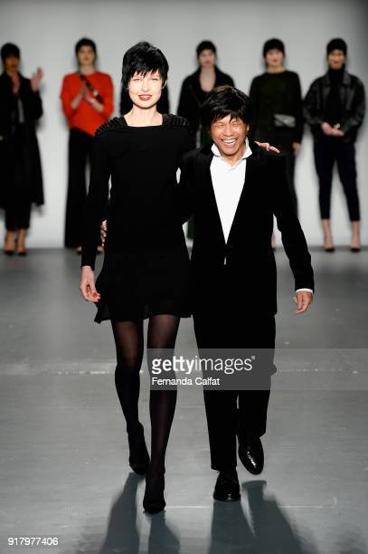 A model and designer Zang Toi walk the runway for Zang Toi during New York Fashion Week The Shows at Pier 59 on February 13 2018 in New York City
