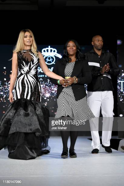 Model and designers walk the runway for Taj B Designs at the House of iKons show during London Fashion Week February 2019 at the Millennium...
