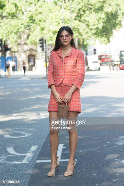 Model and digital influencer Doina Ciobanu wears a Marie Jansen suit Christian Louboutin shoes Karen Walker sunglasses and a Who What Wear bag on day...