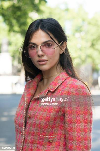 Model and digital influencer Doina Ciobanu wears a Marie Jansen suit and Karen Walker sunglasses on day 3 of London Collections Men on June 11 2017...