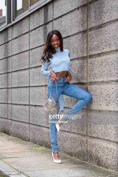 Model and Digital influencer Lauren Lemboumba wears a Zara top, Paco Rabanne bag, Levi Strauss jeans and Fenty shoes on January 08, 2021 in London,...