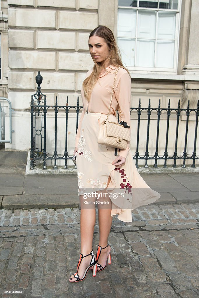Model and DJ Amber Le Bon wears Palma Harding top and dress, Sophia Webster shoes and a Chanel handbag on day 3 of London Collections: Women on February 22, 2015 in London, England.
